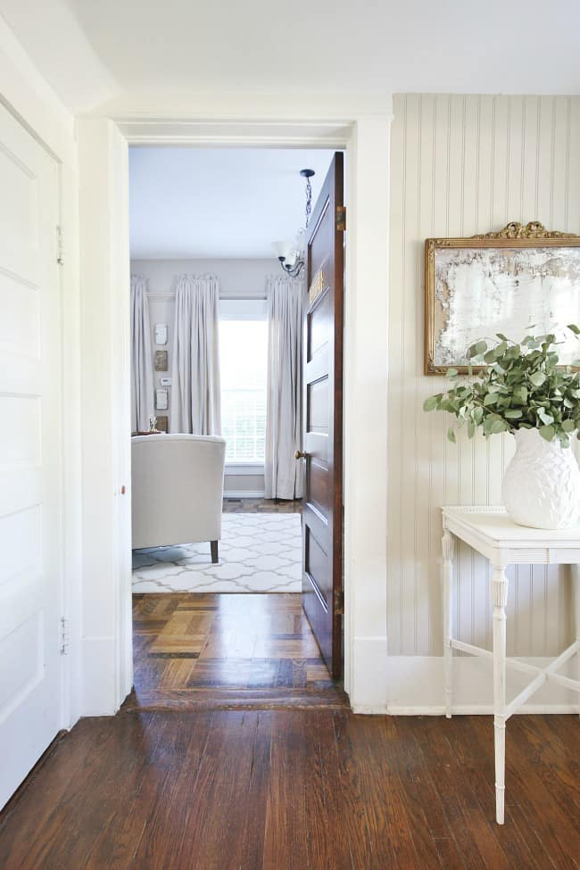 drop cloth curtains in office from hallway with mirror and table