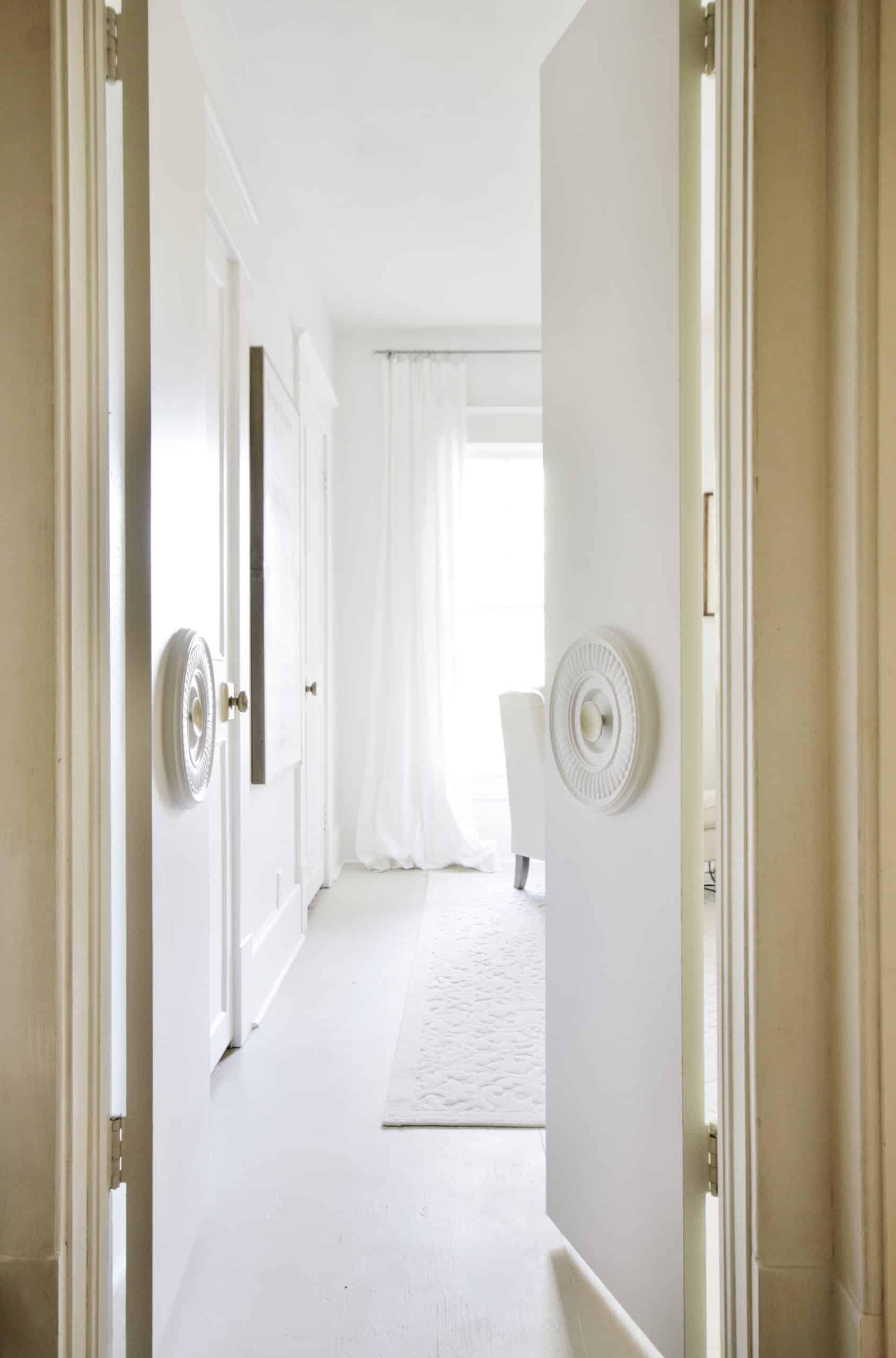 open door peering into bedroom