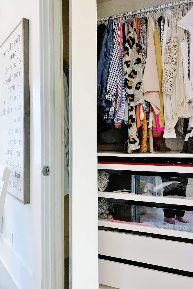 clothes and bins in a closet