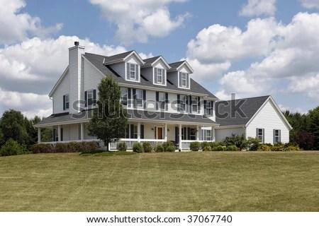 White Suburban Home Blue Shutters Wraparound Stock Photo
