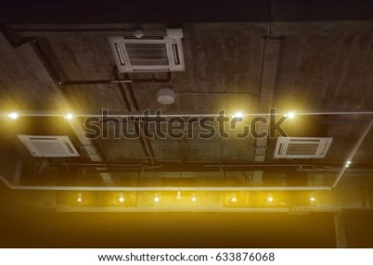 Spotlights On Rail Ceiling Mounted Air Stock Photo  Royalty Free     spotlights on a rail and ceiling mounted air conditioner in exhibition  room  ceiling system