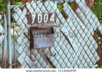 Old Rusty Vintage Mailbox Address Numbers Stock Photo  Royalty Free     Old rusty vintage mailbox with address numbers  House numbers with rusted  mailbox on a fence