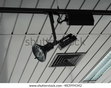 Controlled Track Spotlight On Ceiling Rail Stock Photo  Royalty Free     Controlled track spotlight on ceiling rail system in studio stock image