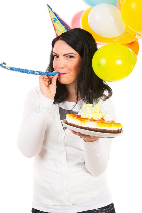 Birthday Woman Blowing Into Party Horn Blower Stock Photo