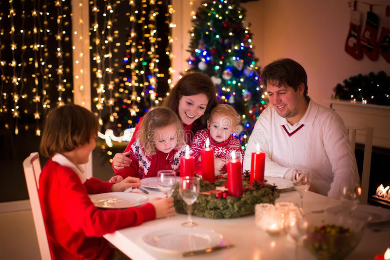 Family Enjoying Christmas Dinner At Home Stock Image