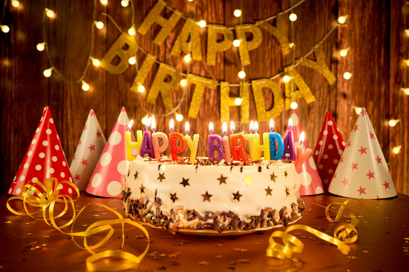 Happy Birthday Cake With Candles On The Background Of Garlands A Stock Photo Image Of