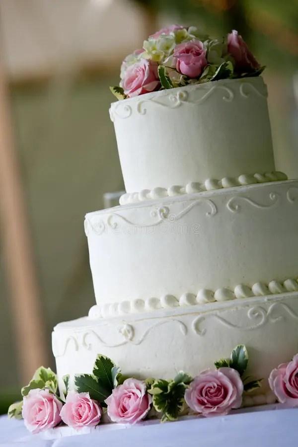 White Wedding Cake With Pink Flowers Stock Photo Image