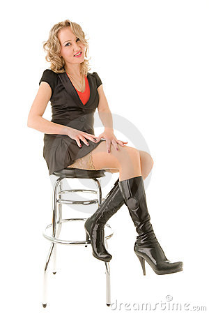 Beautiful Woman Sitting On The Bar Chair Stock Photography