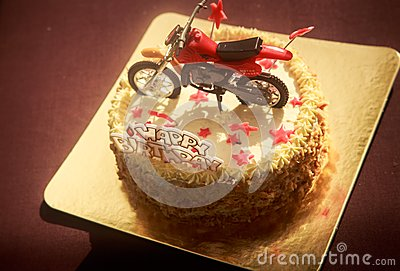 Birthday Cake Decorated With Motorcycle And Red Stars