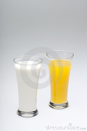 Glasses Of Milk And Orange Juice Royalty Free Stock Images