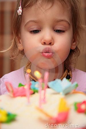 Little Girl Blowing Birthday Candles Stock Photography