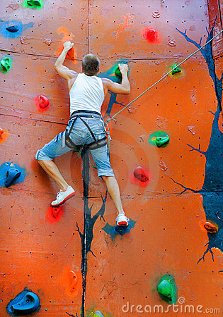 Man Climbing On A Climbing Wall Stock Image Image 21460331