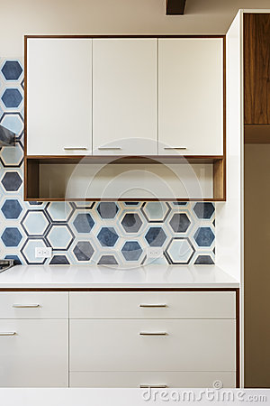 White Kitchen Cabinet In Modern Home With Blue Tile