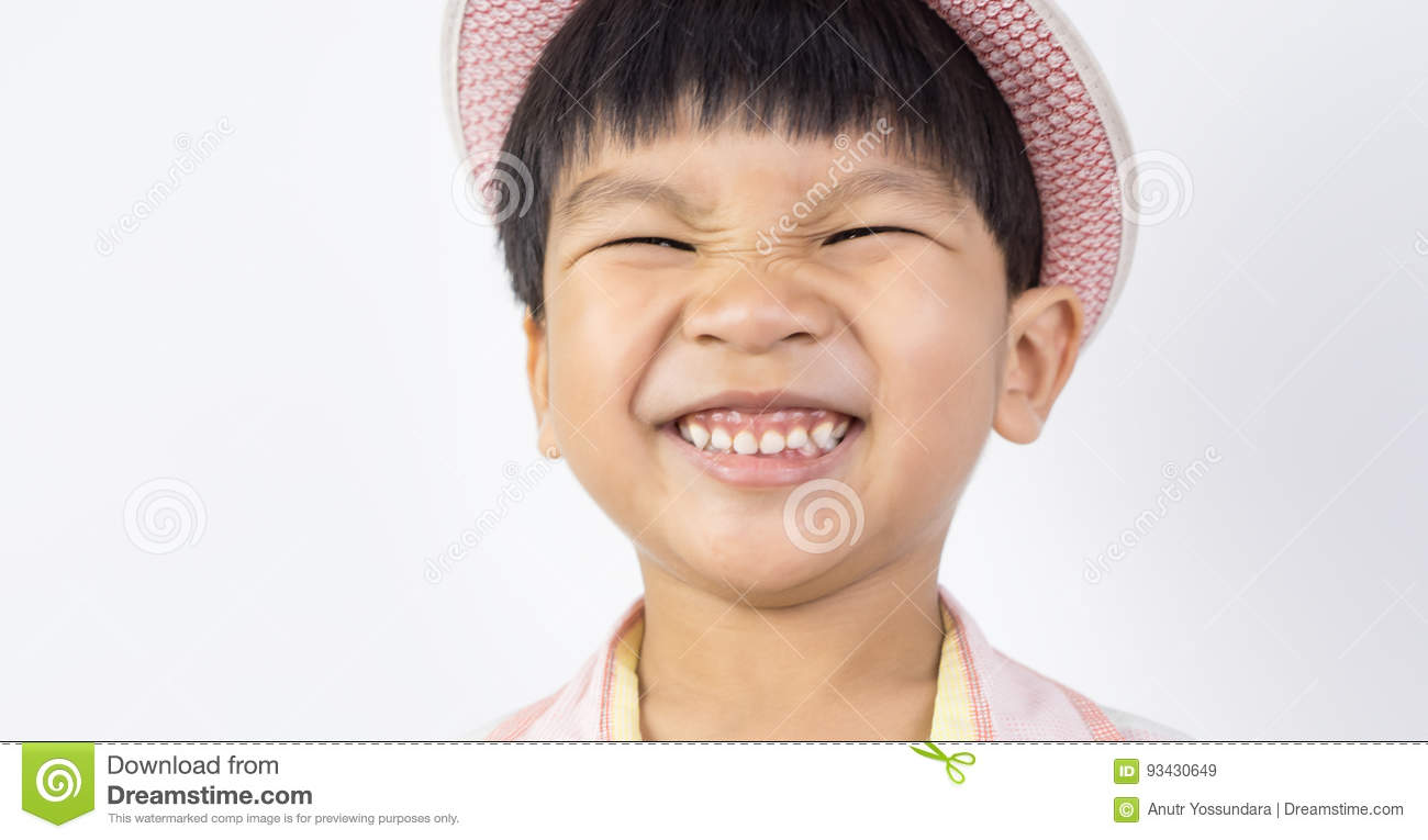 Asian Boy Happily Smiling With Eyes Closed Stock Image ...