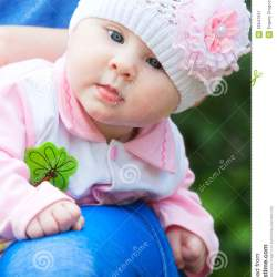 24ea413849d Baby Girl Wearing Knit Hat With Pink Flower Stock Image Image Of