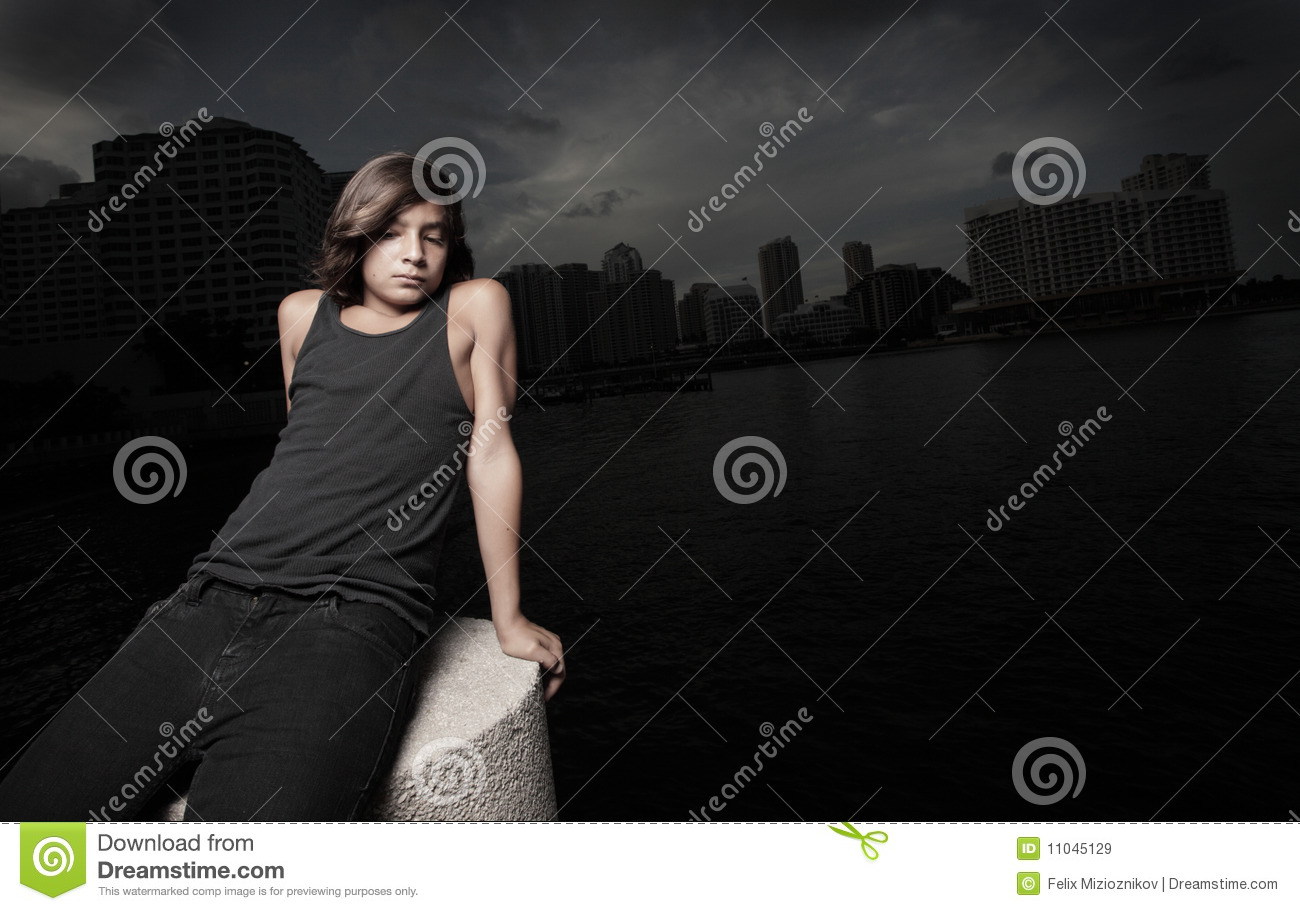 Boy sitting alone at night stock image. Image of outdoors ...