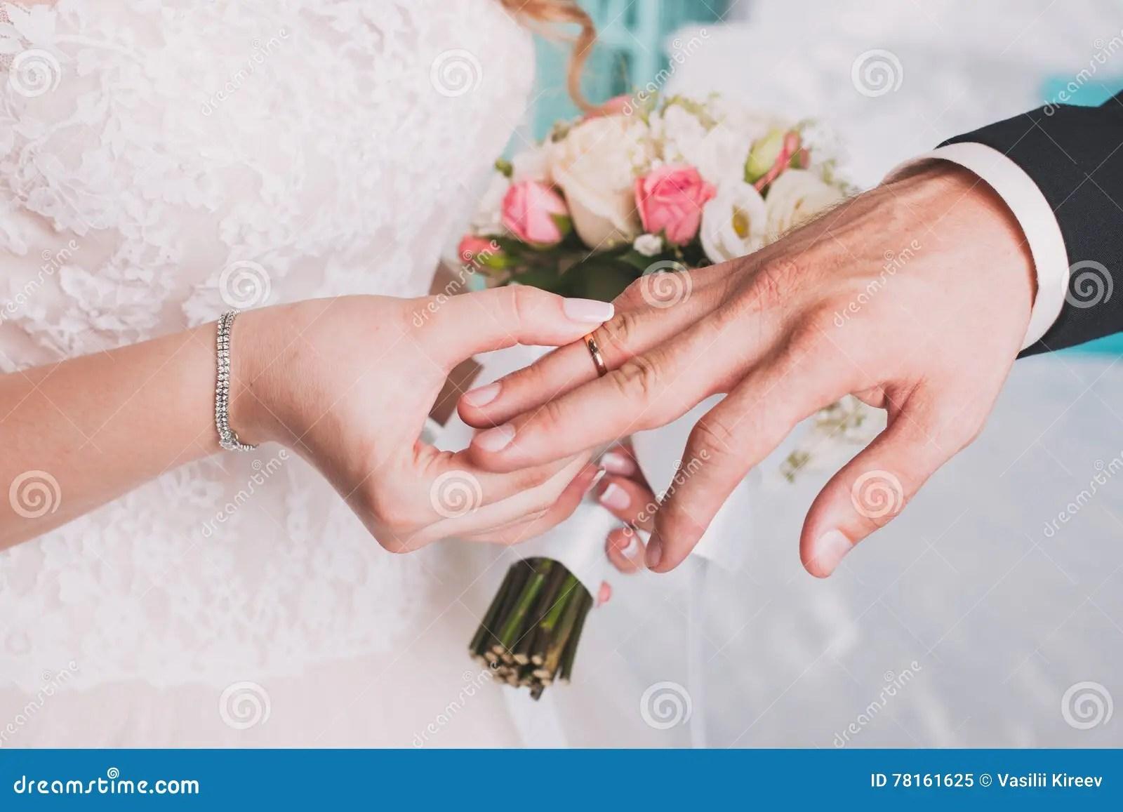 The Couple Exchange Wedding Rings Stock Image - Image of ...