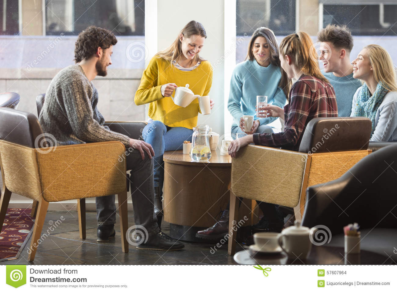 Friends Having Afternoon Tea In A Cafe Stock Photo Image