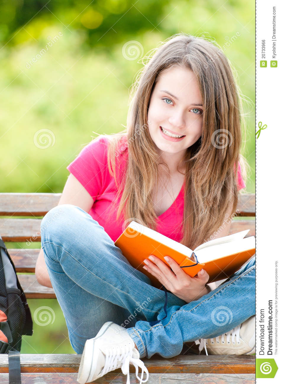 Happy Student Girl Sitting On Bench With Book Royalty Free