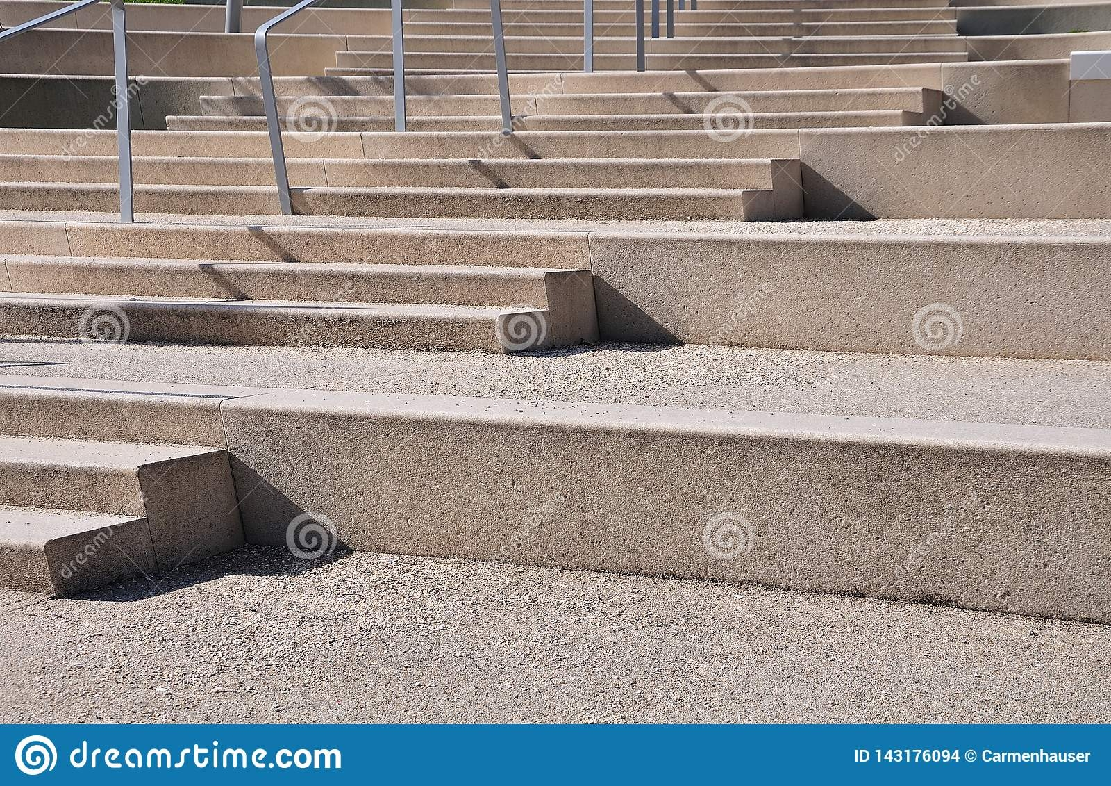 Large Concrete Steps With Railing Of Stainless Steel Stock Photo | Building A Handrail For Concrete Stairs | Deck Railing | Deck | Steel Handrail | Porch | Outdoor Stair