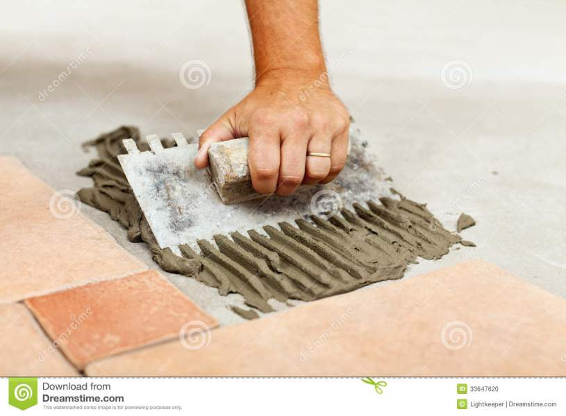 Laying ceramic floor tiles stock photo  Image of material   33647620 Laying ceramic floor tiles