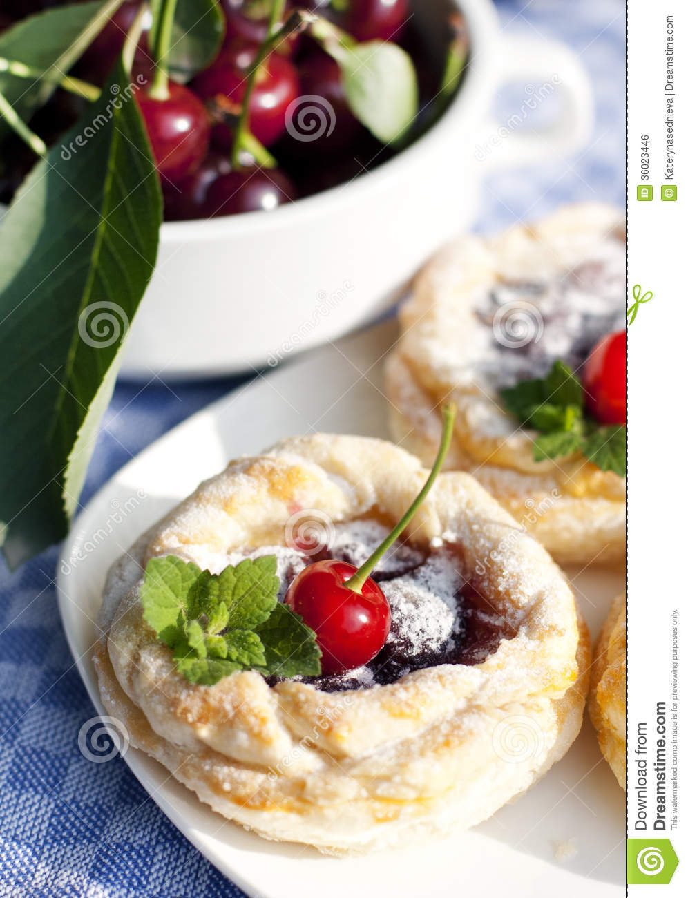 Little Puff Pastry Round Cakes With A Cherry Filling ...