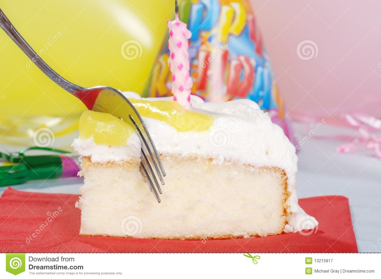 Macro Fork Cutting Birthday Cake With Candle Royalty Free