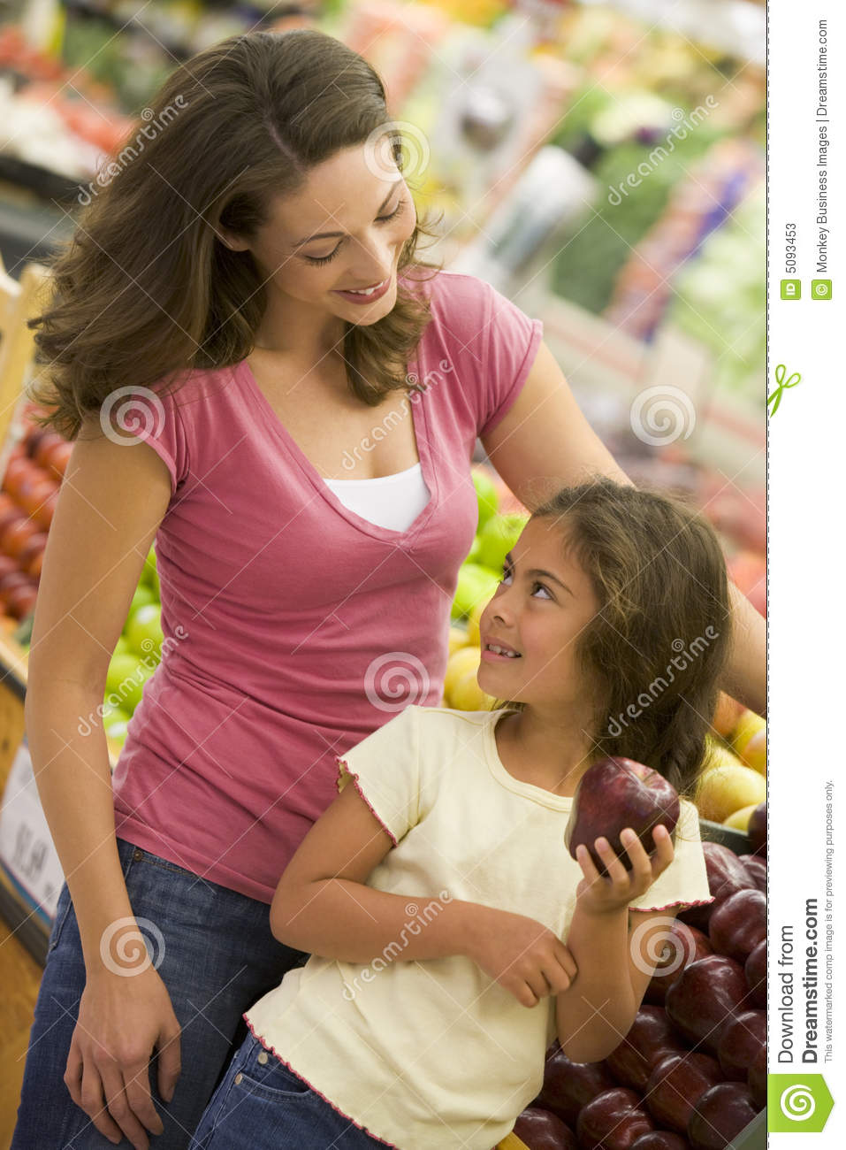 Mother And Daughter Shopping In Produce Section Stock