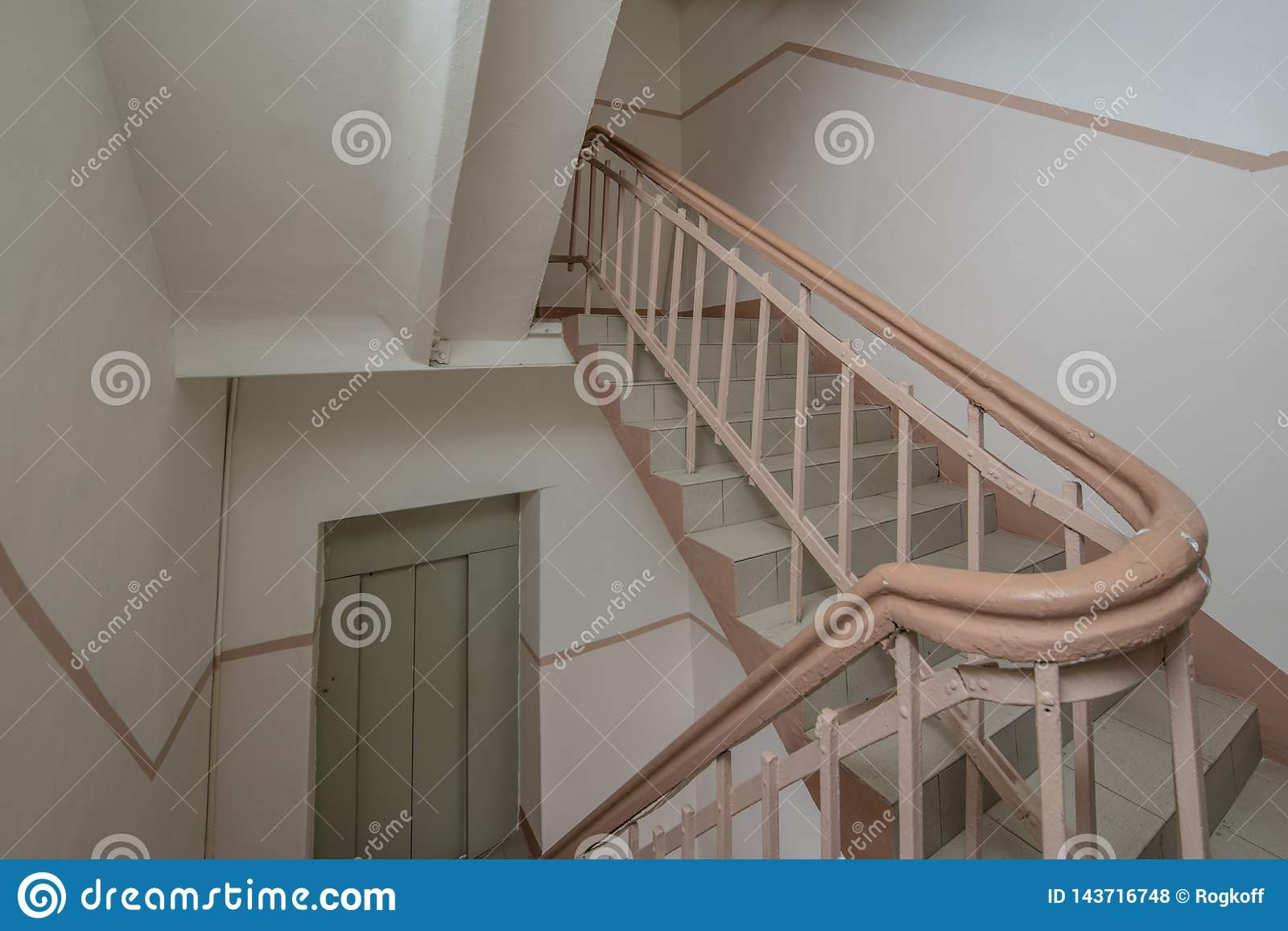 Old Staircase In The Stairwell With Wooden Railing And Wrought | Wrought Iron And Wood Railing | Iron Baluster | Rustic | Split Foyer | Horizontal | Banister