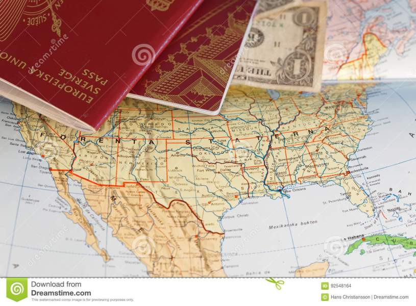 Passport And US Dollar Bill On A Map Of The United States Stock     Download Passport And US Dollar Bill On A Map Of The United States Stock  Photo