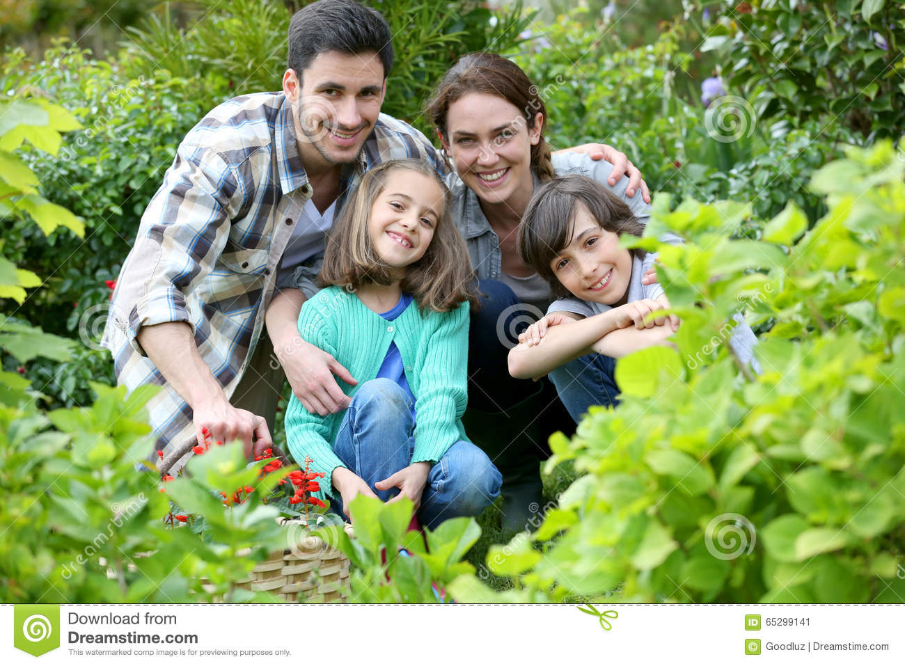 Portrait Of Happy Family In The Garden Stock Image - Image ...
