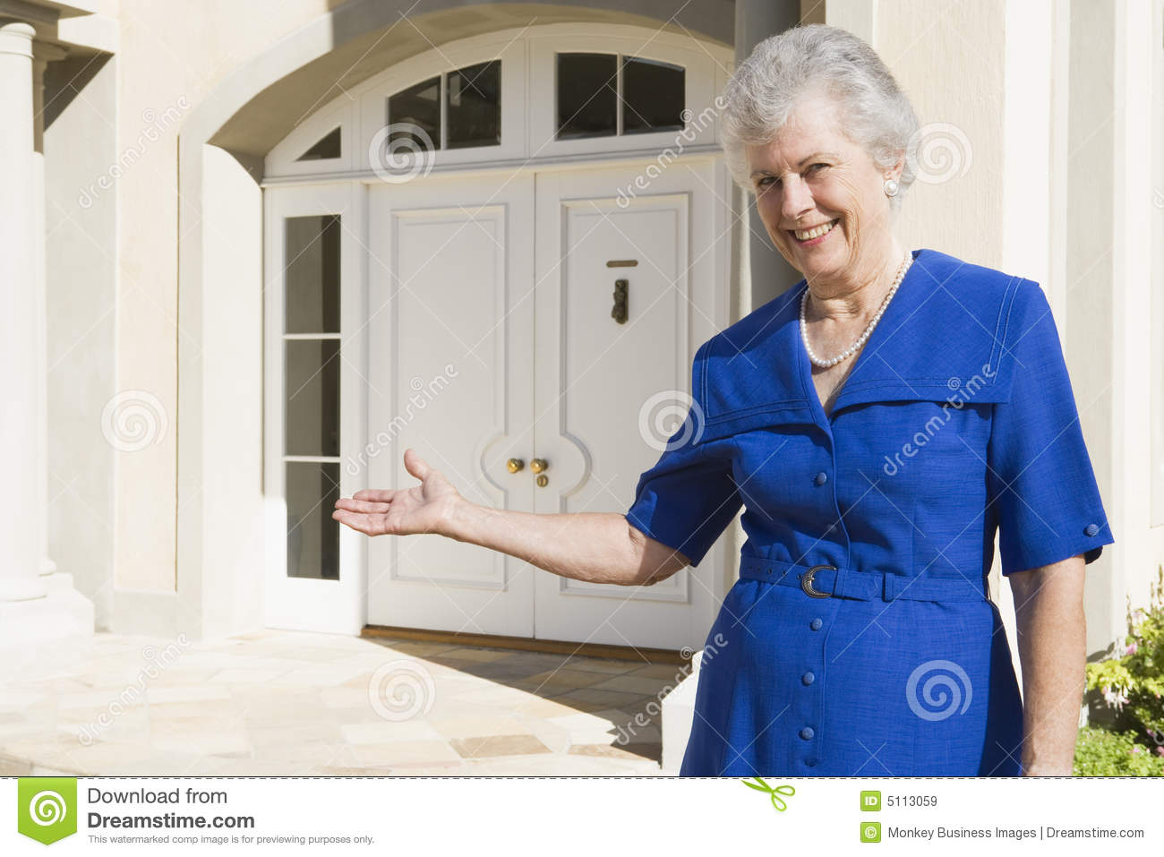 Senior Woman Standing Outside Home Royalty Free Stock