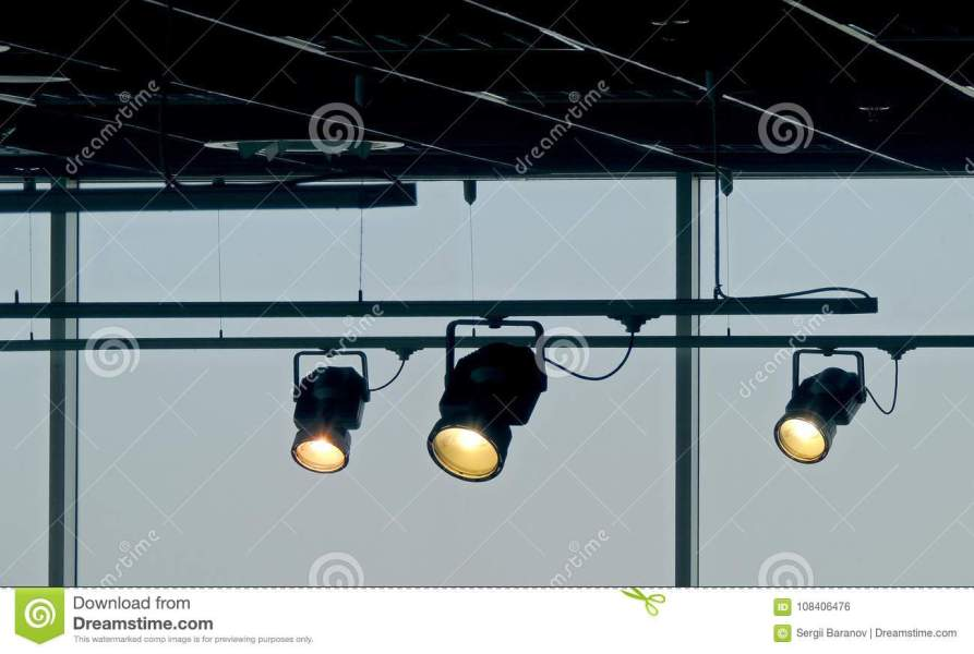 Tracking Spotlights Shines On The Ceiling Rail System Stock Photo     Download Tracking Spotlights Shines On The Ceiling Rail System Stock Photo    Image of lamp