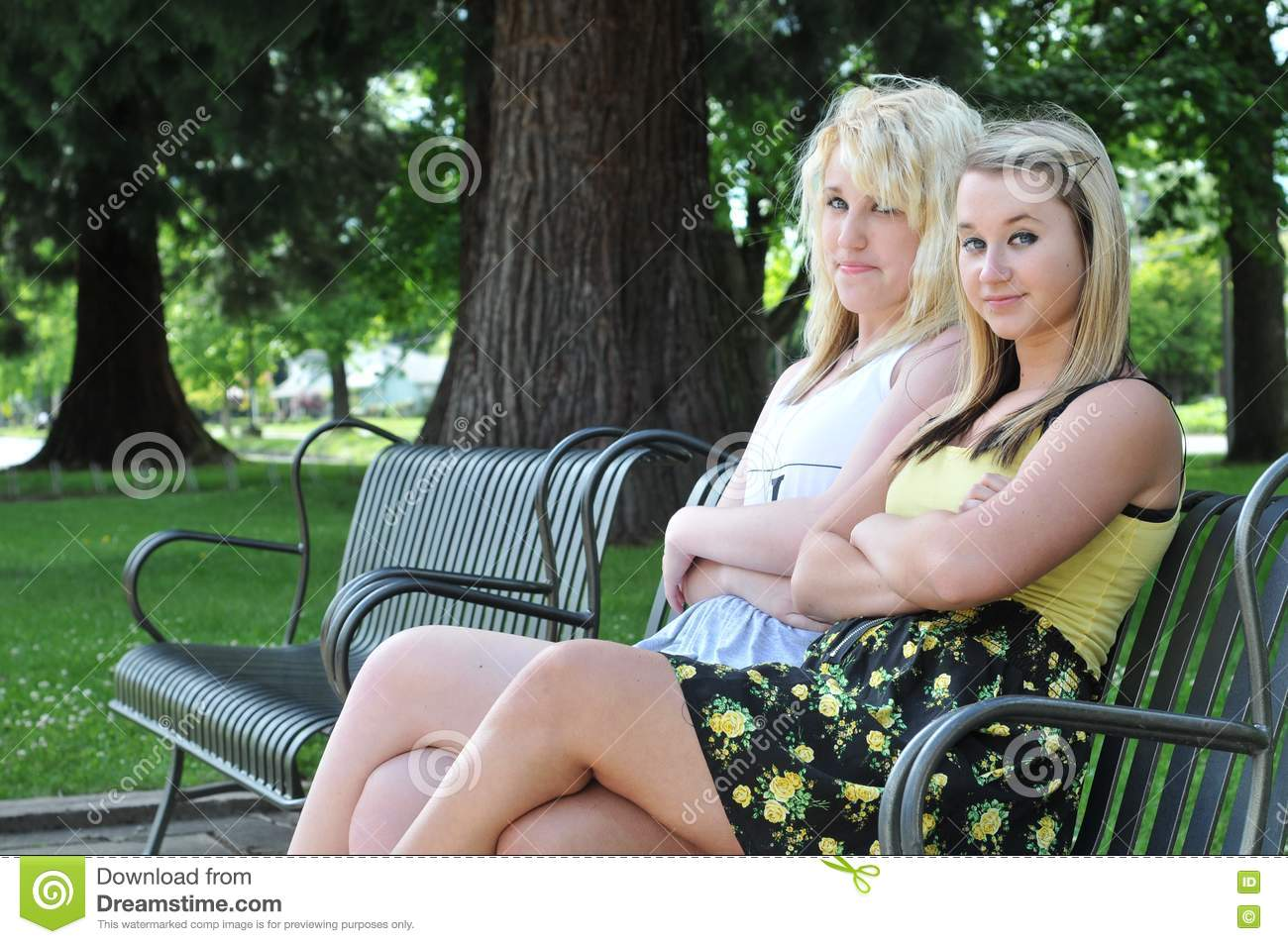Two Girl Friends Sitting On A Bench Stock Image Image Of