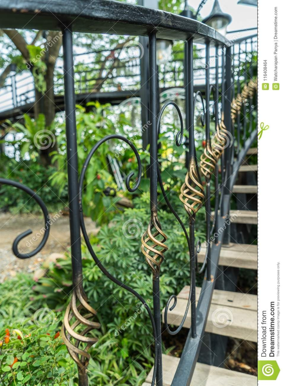 A Detail Of Curved Metal Railing At Outdoor Stairs Stock Photo | Iron Handrails For Outdoor Steps | Deck | Simple | Outside | Free Standing | Galvanized Iron