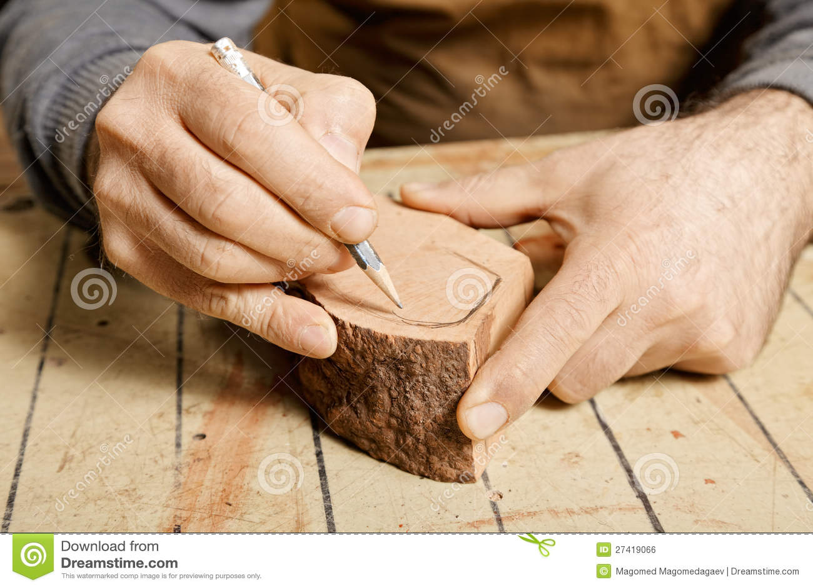 Woodworker Hands Sketching On Wood Billet Royalty Free