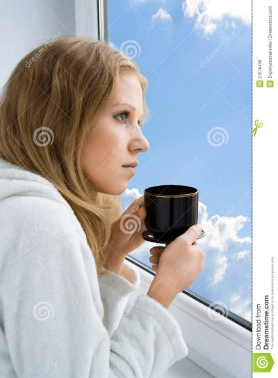 Young Beautiful Girl Drinking Coffee By The Window Stock ...