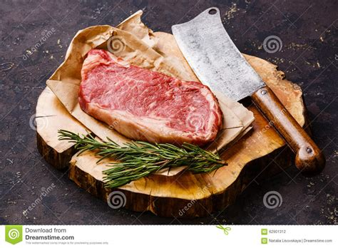 raw meat striploin steak meat cleaver stock photo
