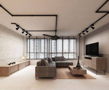 black track lights brick wall grey sofa tracklights