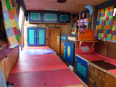 camper van interior build cabinets fridge hob sink