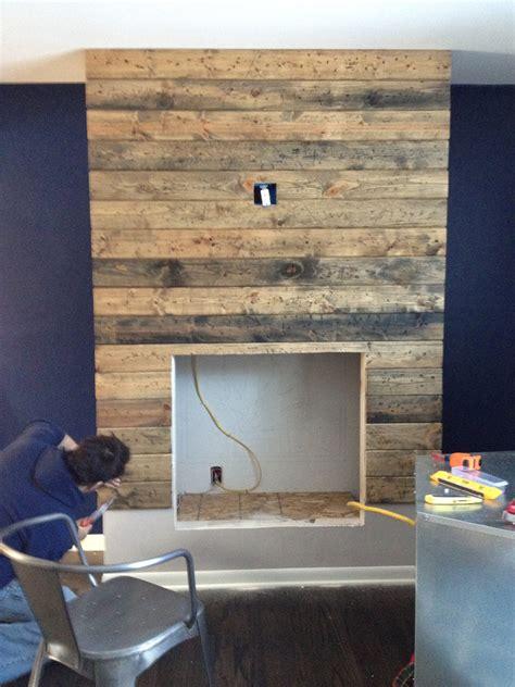 create diy reclaimed wood fireplace surround