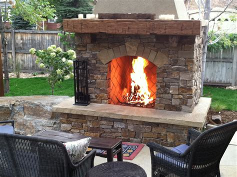 stone fire place reclaimed wood mantle south