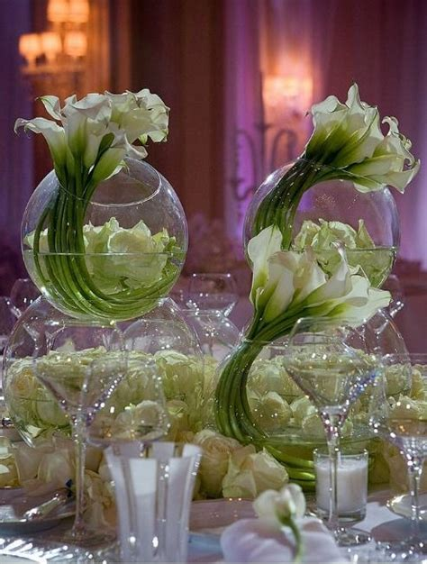 white calla lilies curled circular glass vases striking