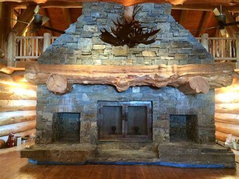 massive stone fireplace wood mantel