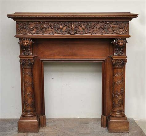 antique walnut fireplace grotesques lions heads