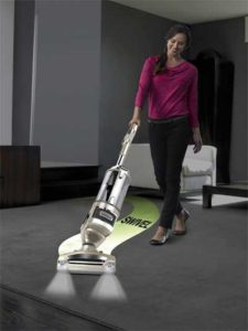 Woman using the Shark Rotator Lift-Away in Cleaning Carpet