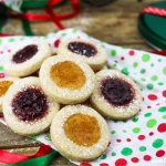 fully baked vegan thumbprint cookies on colored tissue paper.