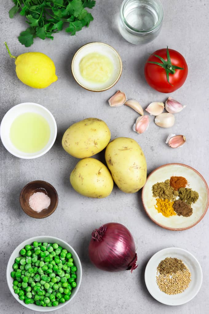 Ingredients for recipe on a stone table top.