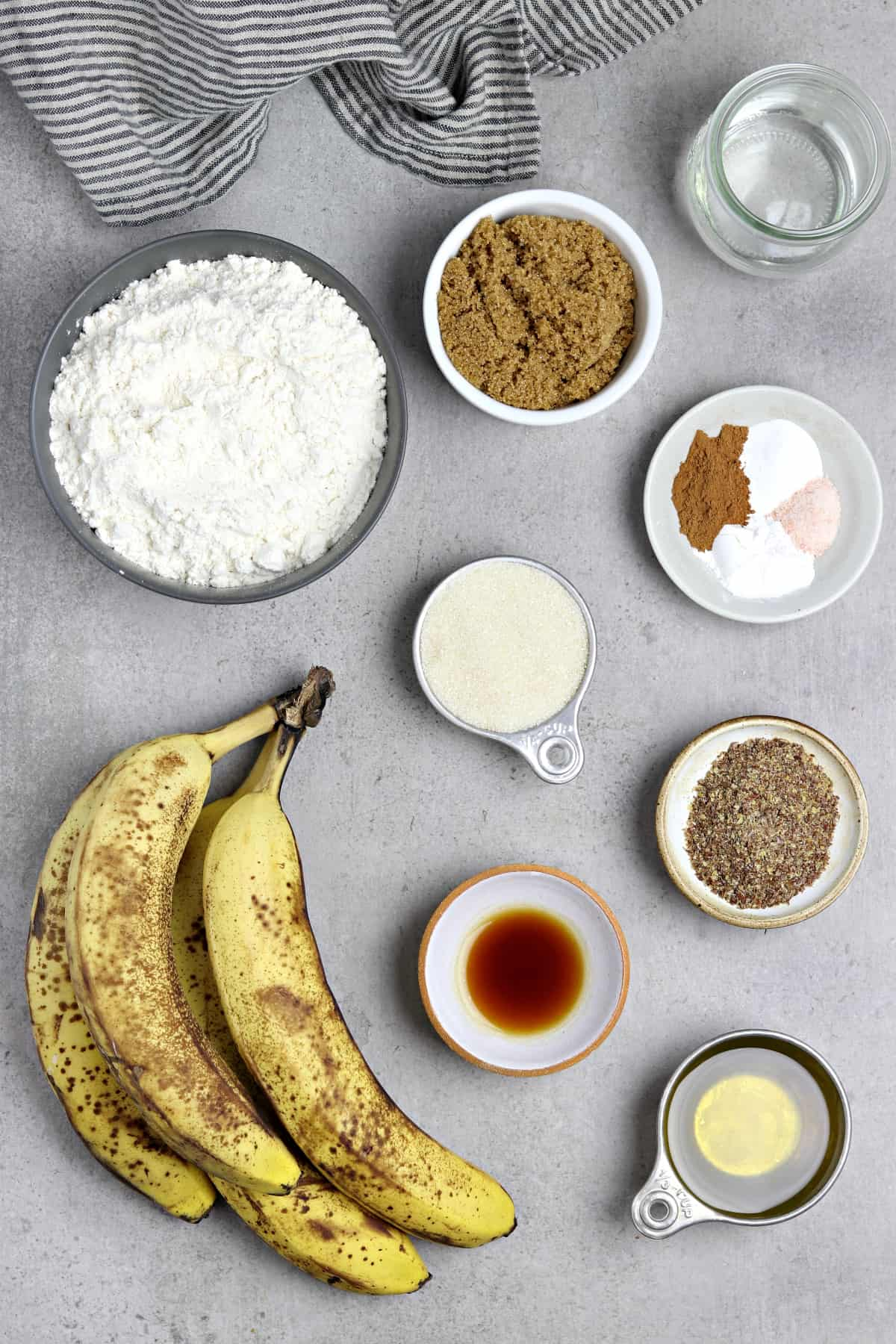 Ingredients to make banana bread on a table top.