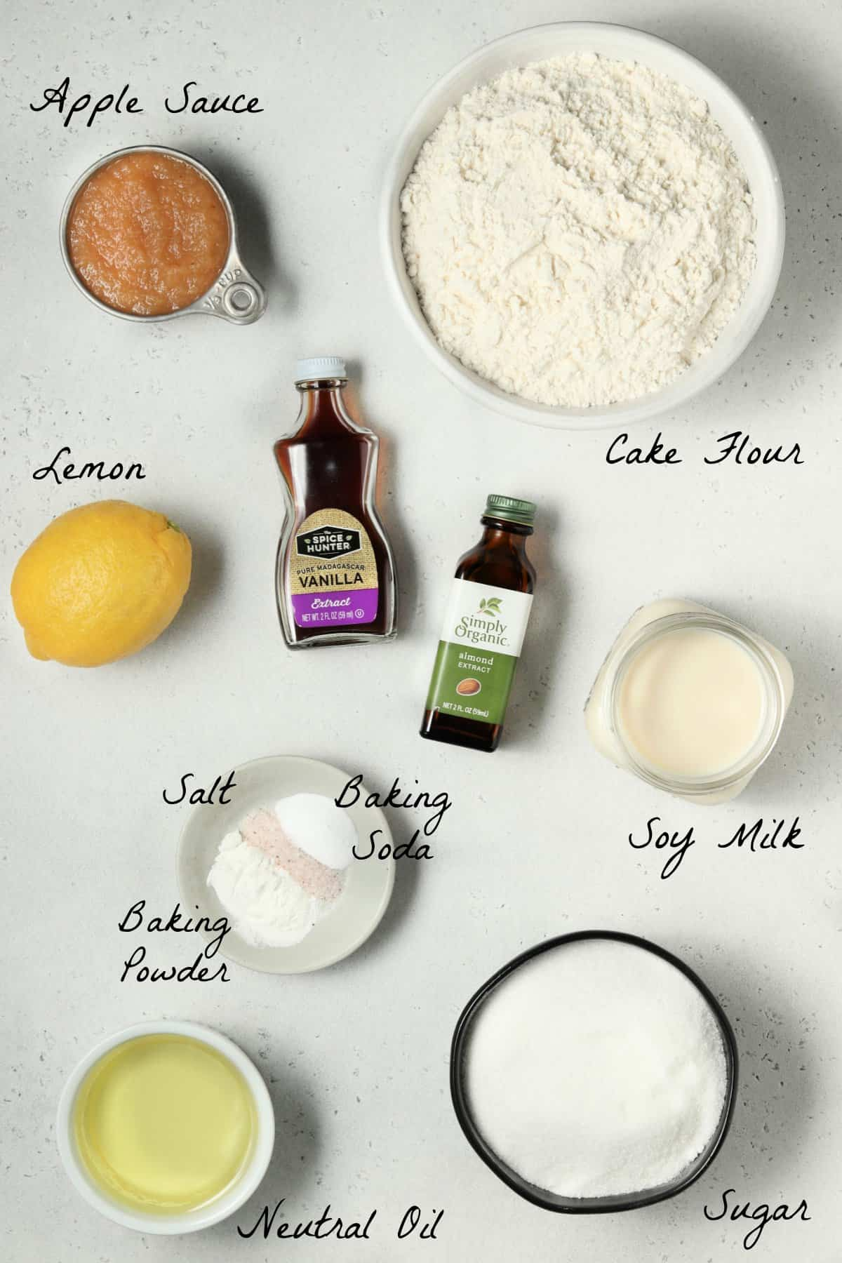 Ingredients to make the cake recipe spread out on a stone table top.